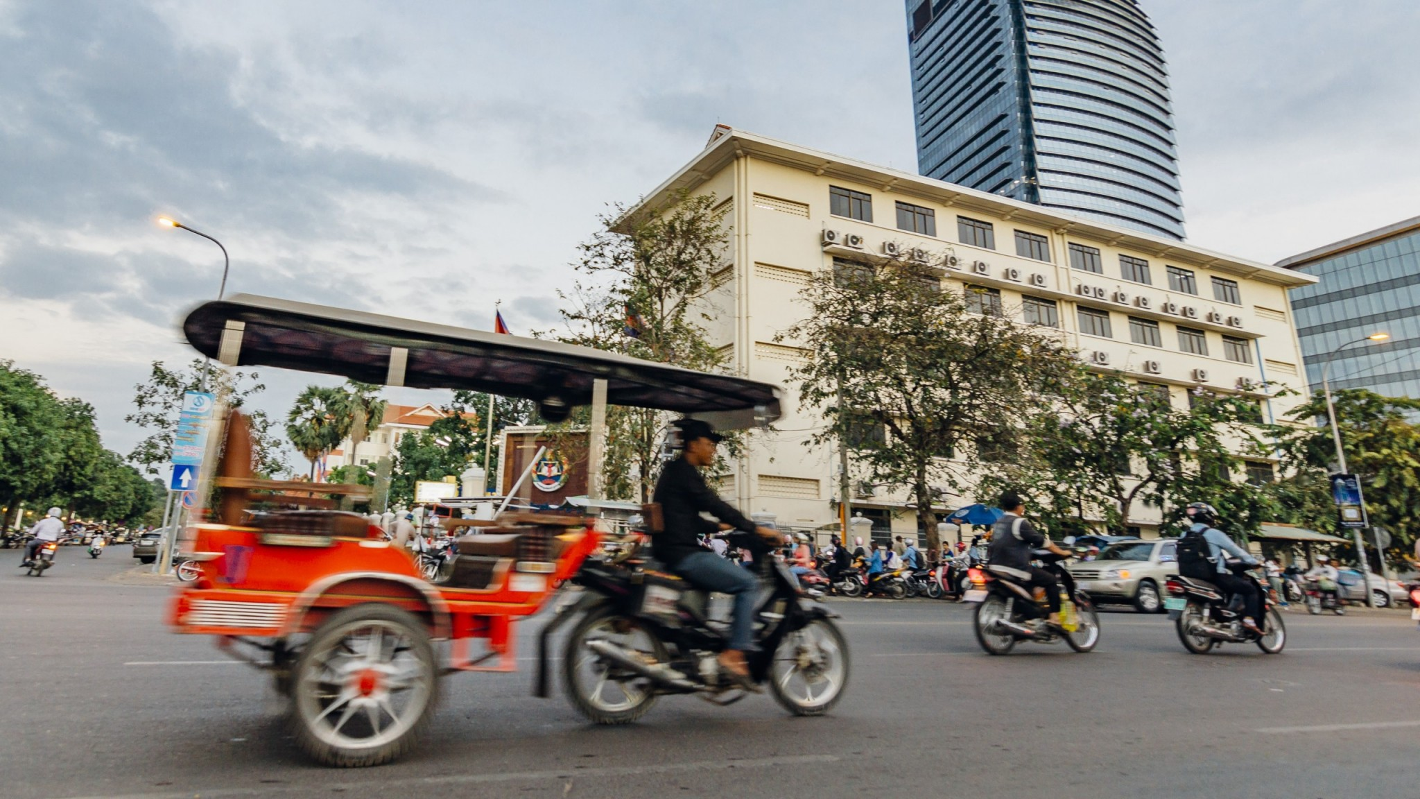People driving motorbikes on the street in Phnom Penh, Cambodia