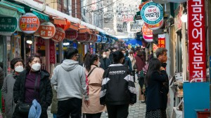 Street and people of traditional market in Haeundae, Busan, South Korea.